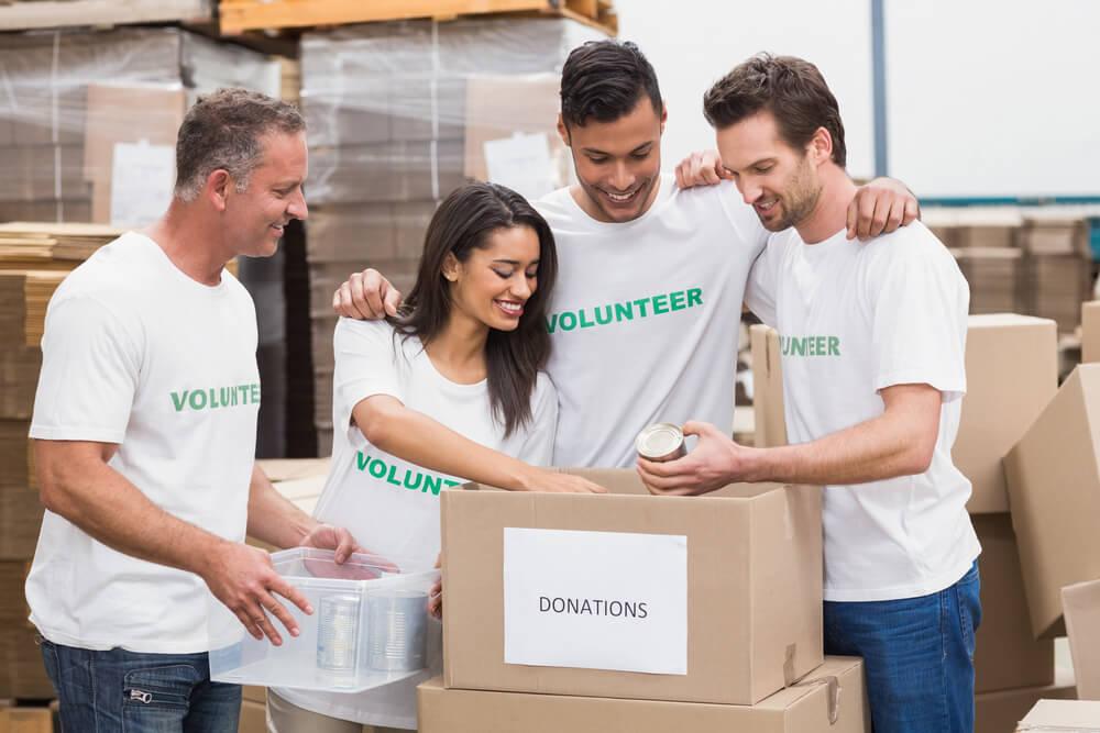 Volunteers sorting donated household items