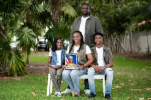 McCoy family with photo of son Keith